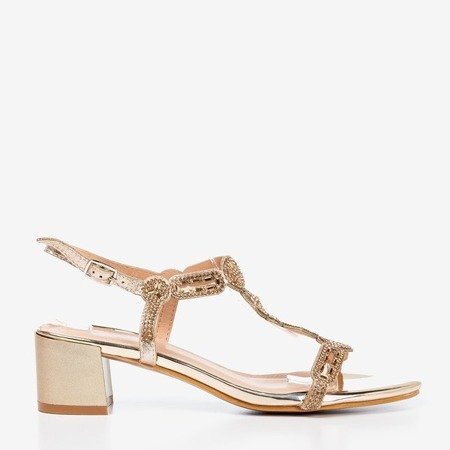 Golden sandals on a low post with cubic zirconia Doremia - Footwear